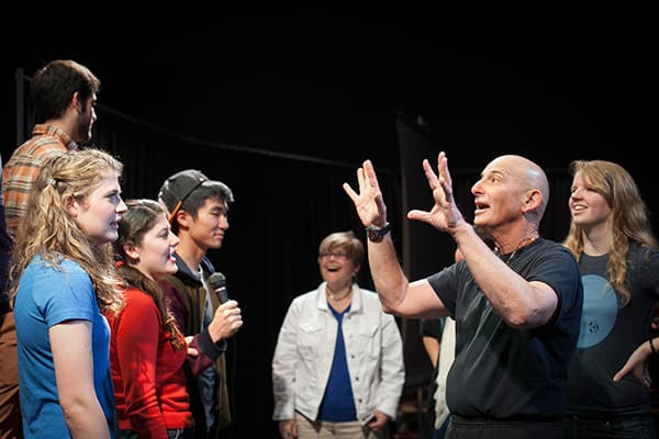 David Feldshuh and Sara Warner, professors of performing and media arts (PMA), teach a theatre class in the Black Box Theatre.
