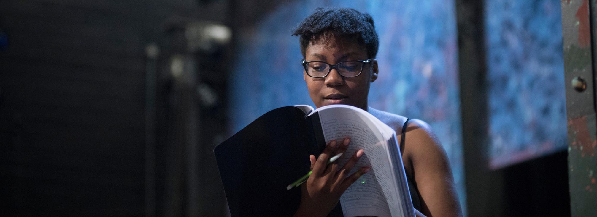 A woman reading a script.