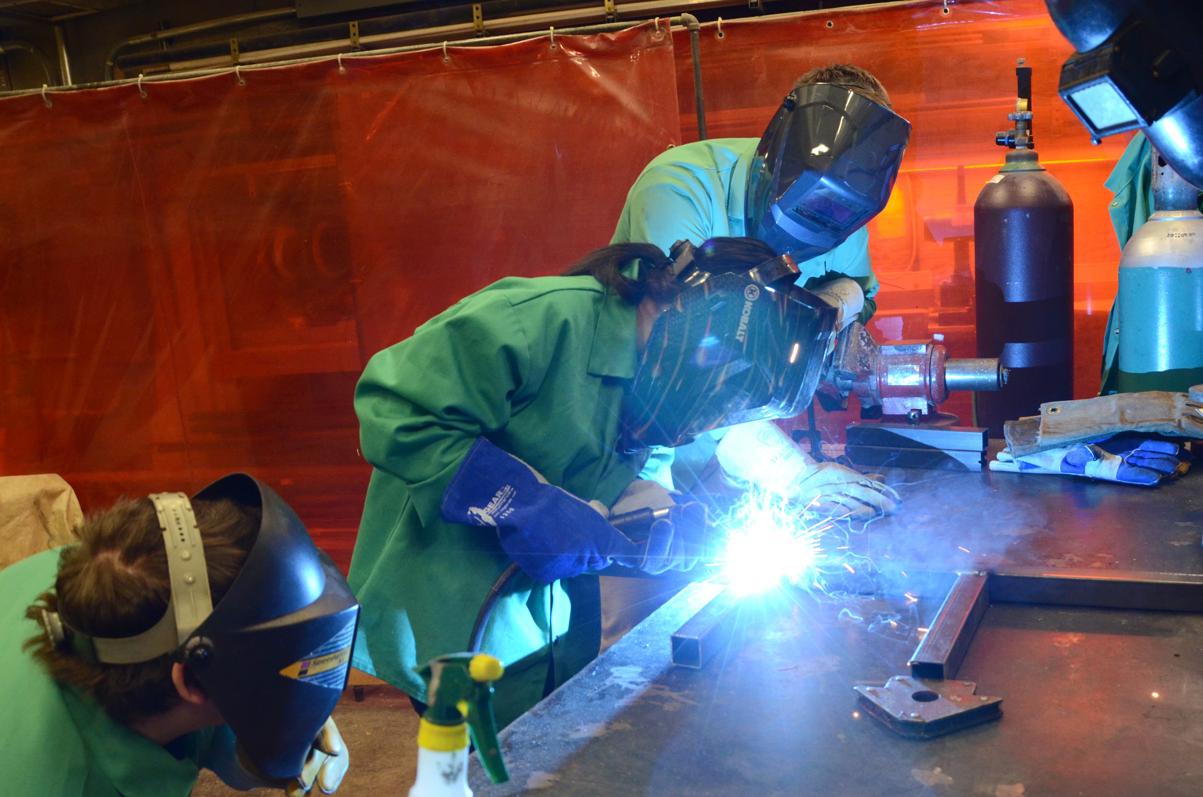 Students welding in the scene shop