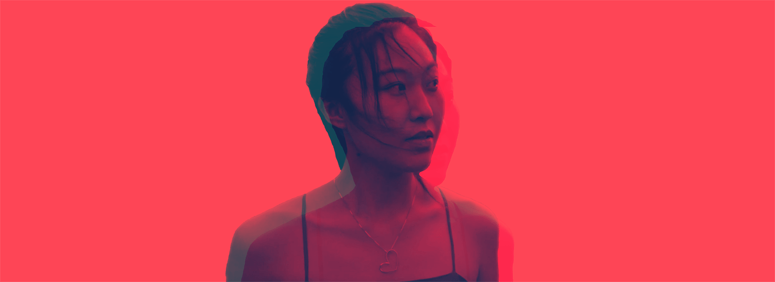 Actress's head duplicated and image slightly distorted on bright red background