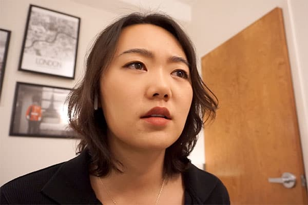 Young woman looking concerned in a room